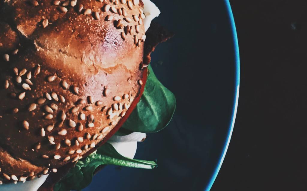 Vegan burger on blue ceramic plate